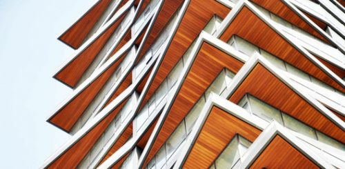 Metal Profiles Coated with Wood Veneers: 7 Options for Applying them to Architecture