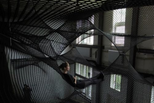 Architecture That Uses Meshes and Nets for Escape, Play and Rest