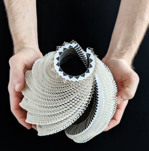 Laser-Cut Paper Coils Into Intricate Vessels That Contrast Human Touch and Technology