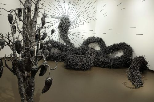 Writhing Organic Sculptures Formed from Nails by John Bisbee