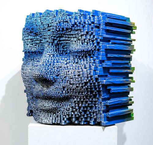Pixelated Wooden Faces by Gil Bruvel Reveal Abstract Color Explorations When Exhibited in Verso