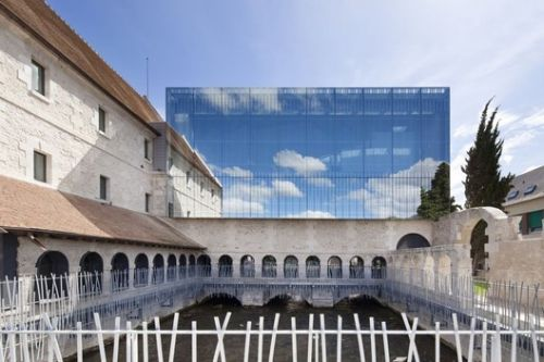 6 Historical Buildings Topped by Contemporary Glass Extensions