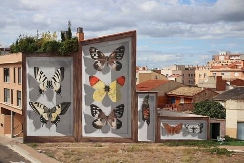 Street Artist Mantra Turns Buildings into Gigantic Butterfly