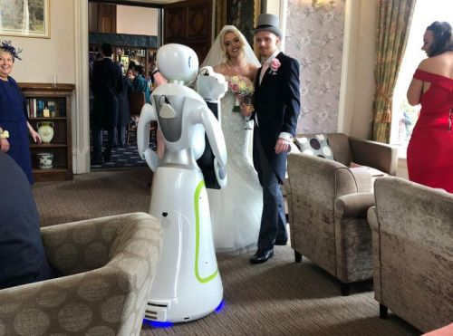 Couple Hires Robot Photographer for Their Wedding