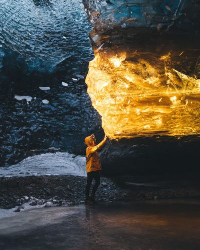 Photographer Captures Sunset Turning Ice Cave Into Amber