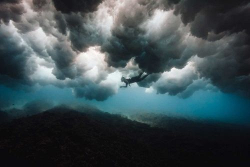 These Epic Underwater Photos Were Shot Below Breaking Waves