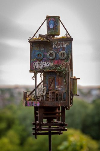 Graffiti-Laden Shelters Arise From an Uncanny Post-Apocalyptic Universe Crafted in Miniature
