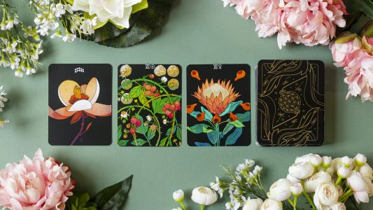 Illustrated Florals Adorn A Gold-Wrapped Tarot Deck Infused with Botanic History