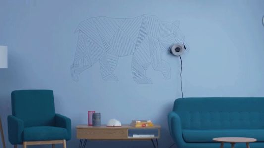 Scribit: the Programmable Robot that Draws on Walls