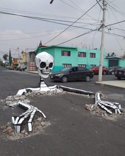 An Enormous Skeleton Emerges in the Middle of a Mexican Street for Día de Muertos