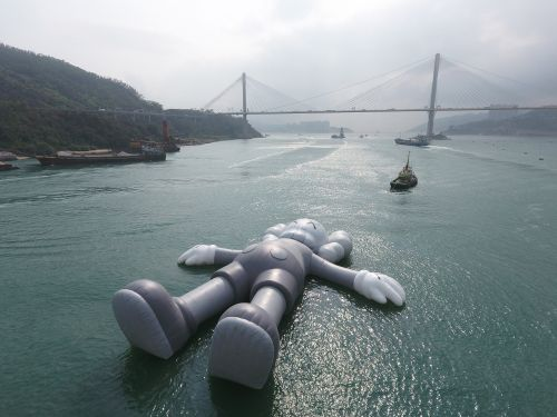KAWS Floats a Massive Inflatable Sculpture in Hong Kong's Victoria Harbour