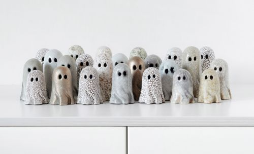 Crackled, Billowing Bedsheets Disguise Miniature Ghosts by Ceramicist Lisa Agnetun