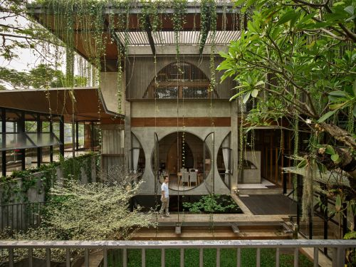 Thick Greenery Swathes a Bamboo-and-Steel Complex in Indonesia