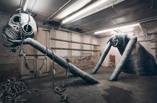 Monochrome Monsters Squeeze into a Former Factory in a New Monumental Exhibition by Phlegm