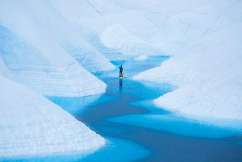 Photos of a Paddleboarder Gliding Through Alaskan Glaciers