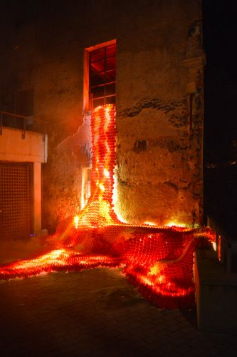 Origami Lava Pours from the Window of an Abandoned Building in Catalonia for LLUÈRNIA