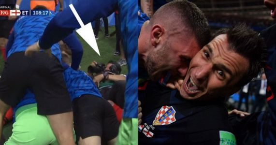 Photographer Gets Dog-Piled at World Cup and Keeps on Shooting