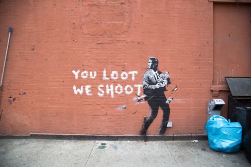 """""""You Loot, We Shoot"""" by Banksy in New York City"""