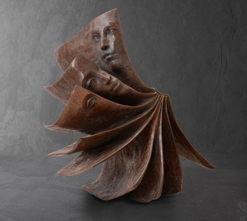 Pensive Faces Peer Out From the Pages of Bronze Book Sculptures by Paola Grizi