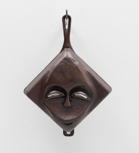Evoking West-African Masks, Faces Emerge from Cast-Iron Skillets by Artist Hugh Hayden