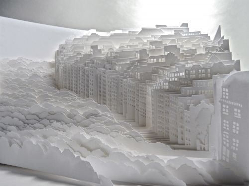 Sheets of White Paper Layered into Dense Cityscapes and Forests by Ayumi Shibata