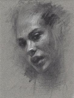 Portrait of a girl charcoal on grey paper