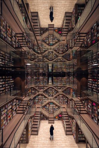 Mirrored Ceilings and Criss-Crossed Stairwells Give a Chinese Bookstore the Feeling of an M.C. Escher Woodcut