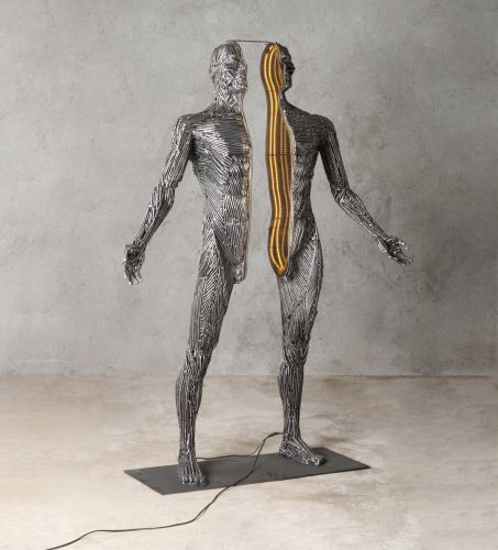 Illuminated Figures Consider the Relationship Between the Body and Soul