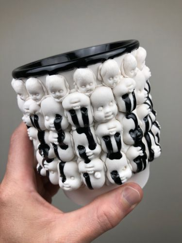 Human Anatomy and Oozing Black Glazes Cover Ceramics by Canopic Studio
