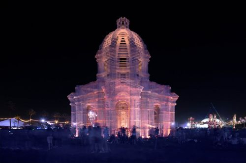 Soaring Wire Mesh Buildings Cast Ethereal Shadows Over Coachella Music Festival