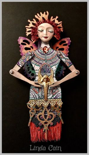 Coral-Crowned Articulated Paintbrush Doll