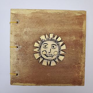 Wooden Book With Sun Embellishment
