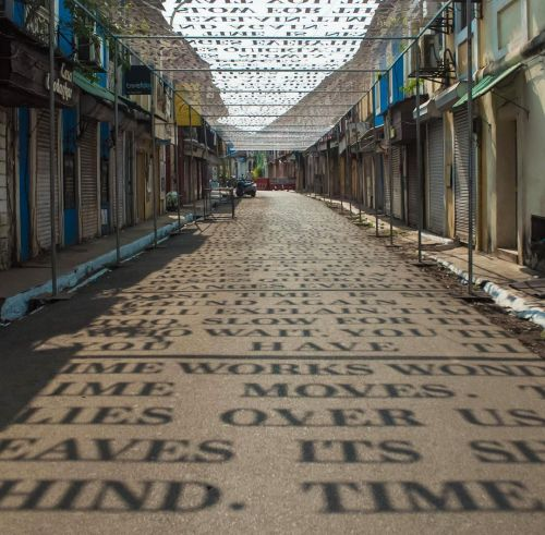 Sunlight Casts Shadows of Phrases Exploring Theories of Time in a Street Art Installation by DAKU