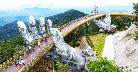 Vietnam's Newly Opened Pedestrian Bridge Lifts Visitors with a Pair of Giant Weathered Hands