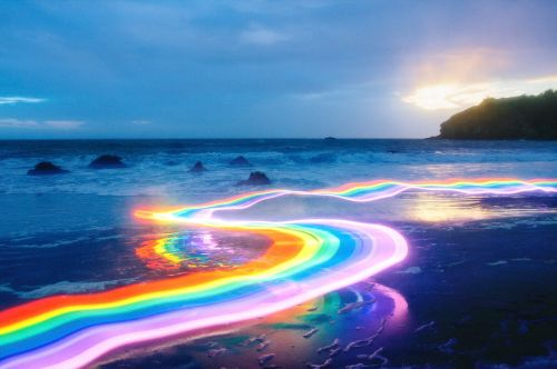 Vivid Rainbow Roads Trace Illuminated Pathways Across Forests and Beaches