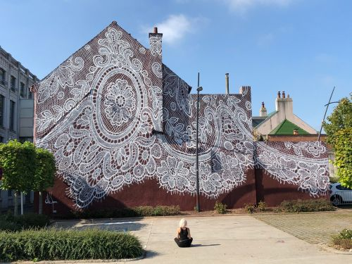 An Intricate Lace Mural Envelops the Facade of a French Fashion Museum