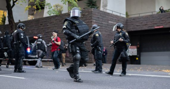 Portland Officer Indicted for 'Excessive Force' on Photog, Riot Squad Resigns
