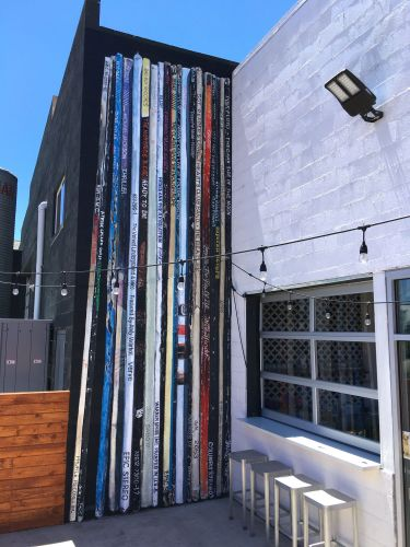 An Oversized and Eclectic Stack of Well-Loved Vinyl Slides into a Corner of a Reno Brewery