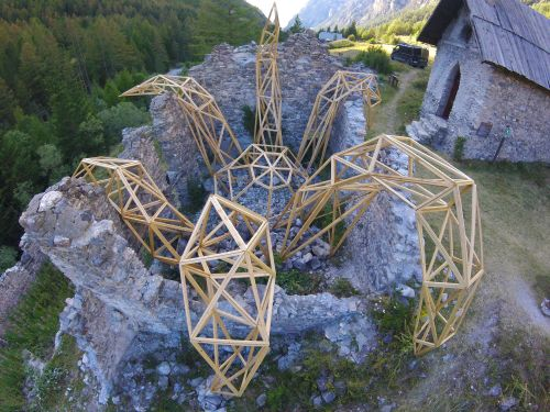 A Skeletal Wooden Kraken Climbs From Remote Ruins in France