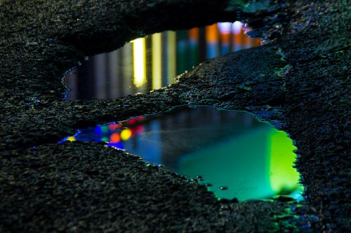 Abstracted Street Puddles Awash in Neon by Slava Semeniuta