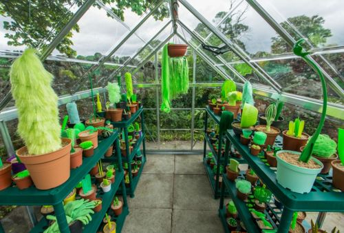 Everyday Plastic Objects Fill a Scottish Greenhouse With Faux Flora