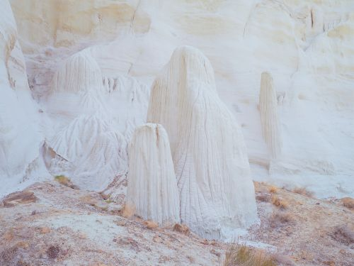 Otherworldly Sandstone Pillars Appear Like Totems of Billowing Fabric