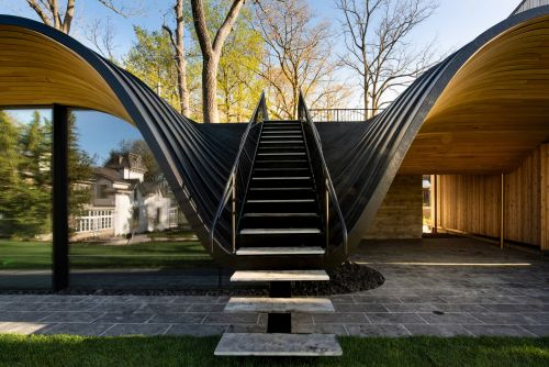 An Undulating Roof Made of Cedar and Steel Flows Out from a Pool House in Ontario