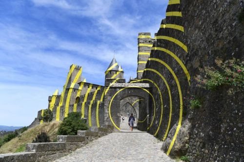 The Walls of a Fortress City in Southern France Ripple With Bright Yellow Concentric Circles