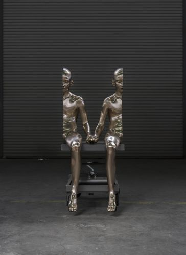 Bisected Bronze Figures by Artist Anders Krisár Rejoin Through Clasped Hands