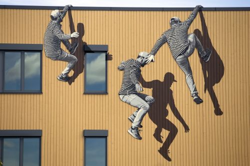 Lithe Black and White Figures Jump and Climb Across Walls in Illustrative Street Art by STRØK