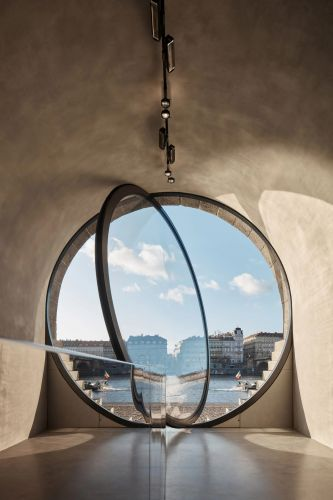 Circular Vaults Embedded within a Prague Embankment Contain Shops, Cafes, and Public Spaces