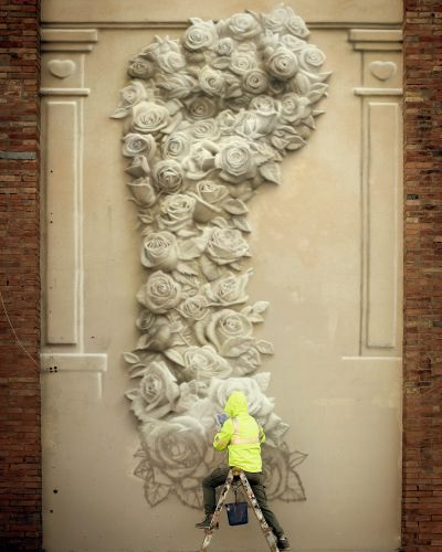 A Fist of Flowers Presents a Message of Unity on the Streets of Santarcangelo